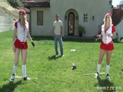 Two cheerleaders Kagney Linn Carter and Lilyth Lavey play football on the field with buddy