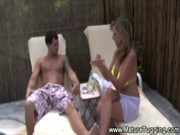Cute eye-catching cougar Jodi West is having rest with young lover on lounge, sucking tool