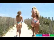 Phoenix Marie and her girlfriend Alexis Texas are walking naked on the sandy way