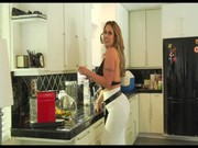 Pretty hot mum Eva Notty is cooking something in the kitchen, attracting attention to tits